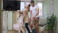 Happy family dancing in slow motion in living room. Joyful Caucasian man woman and girls having fun at home on weekend. Family leisure and happiness concept 77010550