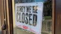 Close sign wooden board hanging on glass door store. Close store or barbershop from COVID-19, start the lockdown and quarantine. 77019410