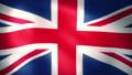 風にはためくイギリス国旗(ユニオンジャック)のCG映像(ループ) 77036943