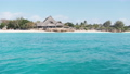 View from Boat to the Coast of Zanzibar with Paradise Beach, Palms, and Hotels 77039066