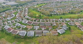 Aerial view urban landscape on small american town a sleeping area home roofs 77047099