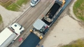 Aerial view Road service lays asphalt on the road. Workers measure the width of the road. Asphalting of the road 77069980