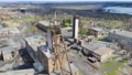 Aerial view Large industrial coal mine. Metal structures and abandoned premises of the old factory. 77070572