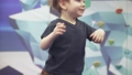 Child on trampolines in an amusement park 77099983