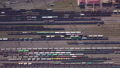 Aerial view of Railway sorting station and A lot of wagons at a railway 77102538
