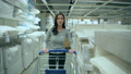 Shopping concept of 4k Resolution. Asian women choosing bedding in the mall. 77106320