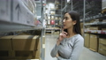 Shopping concept of 4k Resolution. Asian women are paying attention to the goods in the warehouse.  77106321