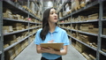 Business concept of 4k Resolution. Asian women are confident to inspect goods in the warehouse. 77106323
