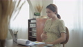 Pregnant woman concept of 4k Resolution. Asian women working paperwork at home on vacation. 77106367