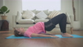 Pregnant woman concept of 4k Resolution. Asian women are exercising with hip lifts in the house. 77106368