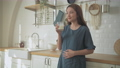 Pregnant woman concept of 4k Resolution. Asian girls are drinking milk in the kitchen. 77106370