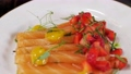 Salmon dishes are laid out in a plate with a beautiful decor. Slow motion. Restaurant dish. The Food Is Clean. Close-up 77108877
