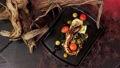 Octopus dishes with beautiful decor. Slow motion picture of food. Restaurant dish. 77109994