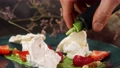 A beautiful portion of dessert, laid out on a plate with a beautiful decor. Slow motion picture of food. Restaurant dish. The Food Is Clean. Close-up 77110002