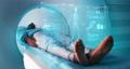 Black patient in futuristic CT machine 77113225
