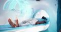 Black man during futuristic full body CT scan 77113227