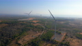 Aerial shot of a group of wind turbines in a semidesert environment. Green energy concept 77129116