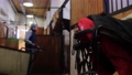 Equestrian - a man is cleaning in stalls 77135838