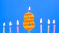 8 Birthday Burning candles. Blue background 77138604