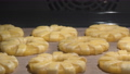 4K Time Lapse of baking of pineapple puff pastry rings in oven 77142687