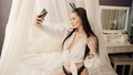 Sexy young woman posing for selfie on mobile phone 77145741