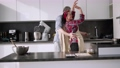 Loving couple dancing romantic dance on date in kitchen 77161859
