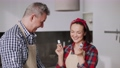 Cheerful couple cooking together with fun and smiling 77161862