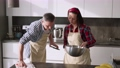 Two male and female couple cooking at kitchen together 77161867