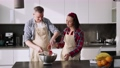 The couple sifting flour to make bread and bakery in kitchen 77161868