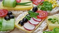 Sandwiches with various fillings. With fresh vegetables. Healthy food concept. View from above. White background 77163502
