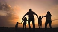 happy family. parent a baby together run in the park at sunset silhouette. people in the park concept. mom dad daughter and son joyful run. happy family and baby fun child summer kid dream concept 77168212