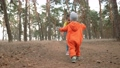 baby run. little boy in orange jumpsuit a walk through the forest fun park. kid dream happy family concept. baby run in the park. happy childhood carefree family walk child in the park 77168220