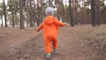 baby run. little boy in orange jumpsuit a walk through the forest park. kid dream happy family concept. baby run in the park. happy childhood carefree family child walk in fun the park 77168228