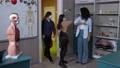 Masked multinational pupils entering classroom 77169053