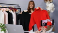 Young woman selling clothes and accessories online by smartphone live streaming, business online e-commerce at home 77170439