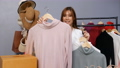 Young woman selling clothes online live streaming, business online e-commerce at home 77170441