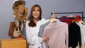 Young woman selling clothes online live streaming, business online e-commerce at home 77170442