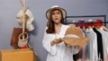 Young woman selling hat and clothes online by smartphone live streaming, business online e-commerce at home 77170445