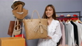 Young woman selling bag online by smartphone live streaming, business online e-commerce at home 77170446
