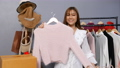 Young woman selling clothes and accessories online by smartphone live streaming, business online e-commerce at home 77170447