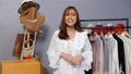 Young woman selling clothes and accessories online live streaming, business online e-commerce at home 77170448