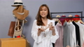 Young woman selling clothes and accessories online live streaming, business online e-commerce at home 77170449