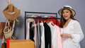 Young woman selling clothes and accessories online by smartphone live streaming, business online e-commerce at home 77170451