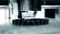 3d printer prints black object close-up. Automatic three dimensional 3D printer 77175521