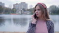 The girl is talking on the phone in the autumn evening. 77177157