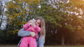 Happy young mother with her baby in the autumn evening. 77177159
