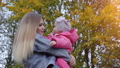 Happy young mother with her baby in the autumn evening. 77177161