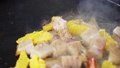 Seafood with peaces of orange are cooking on the grill, close-up in slow motion 77189741
