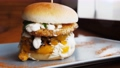 Big and tasty burger on the plate, close up 77190563