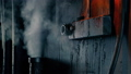 Pipe Blasts Steam In Grungy Industrial Setting 77242668